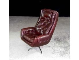 Кожаное кресло качающееся